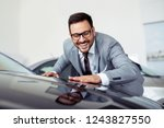 happy businessman touching car... | Shutterstock . vector #1243827550