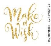 make a wish brush hand... | Shutterstock .eps vector #1243903423
