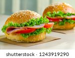 appetizing sesame buns with... | Shutterstock . vector #1243919290