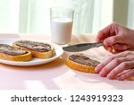 spread chocolate paste on... | Shutterstock . vector #1243919323