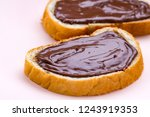 pieces of loaf with chocolate... | Shutterstock . vector #1243919353