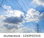 electric pole power lines and... | Shutterstock . vector #1243932310