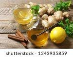 ginger tea with lemon in glass...   Shutterstock . vector #1243935859