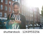 woman texting on her phone in... | Shutterstock . vector #1243953256