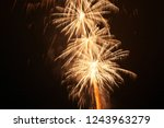 colorful fireworks at holiday... | Shutterstock . vector #1243963279