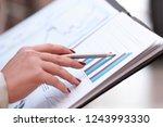 close up.business woman checks... | Shutterstock . vector #1243993330