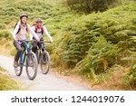 young adult couple riding...   Shutterstock . vector #1244019076