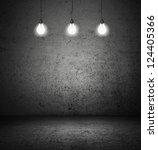 Dark room with three light bulbs