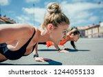 two young sportswomen doing... | Shutterstock . vector #1244055133