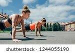 two young sportswomen doing... | Shutterstock . vector #1244055190