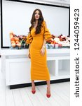 fashion young model in yellow... | Shutterstock . vector #1244059423
