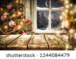 dark wooden table with window...   Shutterstock . vector #1244084479