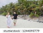 happy young couple walking... | Shutterstock . vector #1244093779
