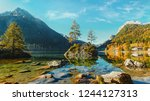 amazing sunny landscape at... | Shutterstock . vector #1244127313