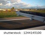plane landing in the airport of ...   Shutterstock . vector #1244145100