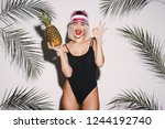 girl with blonde hair wearing... | Shutterstock . vector #1244192740
