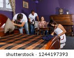 group of young adults trying to ... | Shutterstock . vector #1244197393