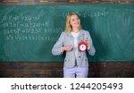 woman teacher hold alarm clock. ... | Shutterstock . vector #1244205493