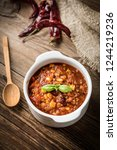 mexican chili con carne in bowl.... | Shutterstock . vector #1244219236