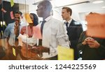 young african businessman and... | Shutterstock . vector #1244225569