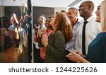 diverse group of smiling... | Shutterstock . vector #1244225626