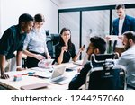diverse team of professional... | Shutterstock . vector #1244257060