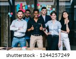 successful team of... | Shutterstock . vector #1244257249