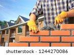 bricklayer industrial worker... | Shutterstock . vector #1244270086