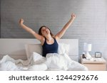 woman waking up in the morning... | Shutterstock . vector #1244292676
