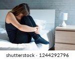 woman hiding her face feeling... | Shutterstock . vector #1244292796