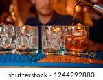 bartender is making cocktail at ... | Shutterstock . vector #1244292880
