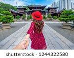 women tourists holding man's... | Shutterstock . vector #1244322580