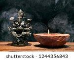 Hindu God Ganesha On Black...