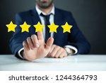 man touching in stars in screen | Shutterstock . vector #1244364793