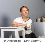 beautiful blonde woman smiling...   Shutterstock . vector #1244388940