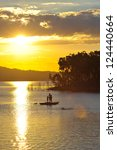 Small photo of Family Swimming at sunset at Awoonga Dam, Gladstone, Australia