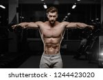 sexy strong bodybuilder... | Shutterstock . vector #1244423020