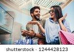 beautiful young couple enjoying ... | Shutterstock . vector #1244428123