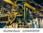 old machines and tools in an... | Shutterstock . vector #1244443939