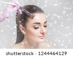 the cosmetologist makes the... | Shutterstock . vector #1244464129