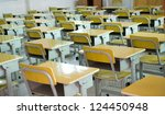 desk and chairs in classroom. | Shutterstock . vector #124450948
