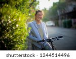 toothy smiling face of asian... | Shutterstock . vector #1244514496