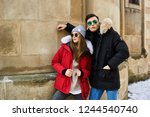 a trendy young couple walks in... | Shutterstock . vector #1244540740