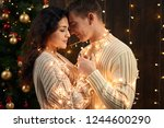 young couple is in christmas... | Shutterstock . vector #1244600290