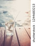 cocktail at the wooden pier... | Shutterstock . vector #1244683213