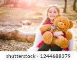 cute young mixed race girl... | Shutterstock . vector #1244688379