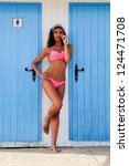 Portrait of a woman with beautiful body in a beach hut - stock photo