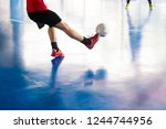 select focus to futsal player... | Shutterstock . vector #1244744956