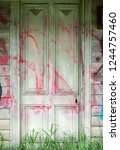 an old door to an abandoned... | Shutterstock . vector #1244757460