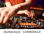 dj mixes the track in the... | Shutterstock . vector #1244820613
